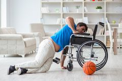 The young basketball player on wheelchair recovering from injury Royalty Free Stock Photos