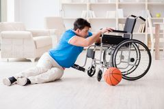 The young basketball player on wheelchair recovering from injury Stock Image