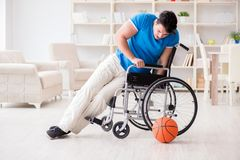 The young basketball player on wheelchair recovering from injury Royalty Free Stock Photography