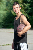 Young Basketball Player With Ball Stock Photo
