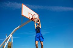 Young Basketball street player making slam dunk.  Stock Images