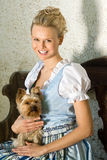 Young Bavarian beauty with dog Royalty Free Stock Photos