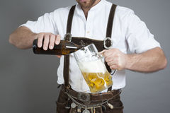 Young bavarian with a beer Royalty Free Stock Photos