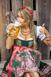 Young bavarian oktoberfest blonde woman in a dirndl dress with beer Stock Photography