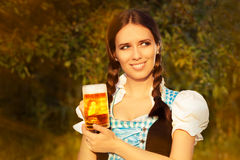 Young Bavarian Woman Holding Beer Tankard Royalty Free Stock Image