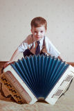 The young bayan player. Royalty Free Stock Image