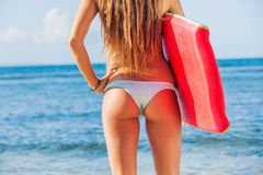 Young Beautiful in Bikini at the Beach with Boogie Board Stock Image