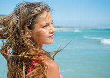 Young beach girl Stock Images
