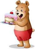 Young Bear Holding A Cake Stock Photo