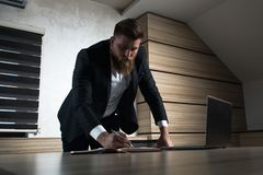 Young beard businessman late night work in office royalty free stock photography