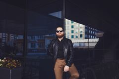 Young beard man posing in the street royalty free stock photo