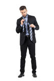 Young bearded business man getting dressed Stock Photos