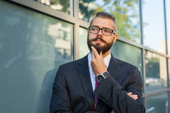 Young bearded businessman thinking abut plans for the weekend. Stock Photography