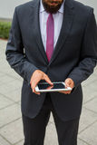 Young bearded businessman writting business e-mail using his tablet Stock Photos
