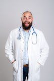 Young bearded doctor looking amazed Stock Photos