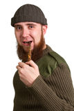 Young bearded guy smoking a pipe Royalty Free Stock Photo