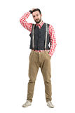 Young bearded hipster with hand through hair Royalty Free Stock Photo