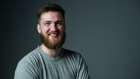 Young bearded hipster man happy laughing looking at camera stock footage
