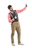 Young bearded hipster model taking selfie with thumbs up. Stock Photos