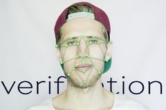 Young bearded hipster in a snapback cap biometric face scan isolated stock photo
