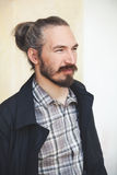 Young bearded long haired Asian man Royalty Free Stock Photos