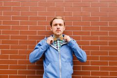 Young bearded male with wooden bowtie in casual wear Royalty Free Stock Photo
