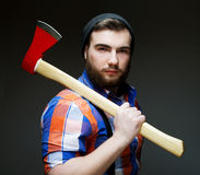 Young bearded man with  big axe Stock Images