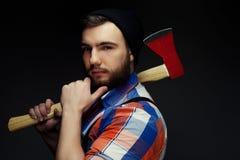 Young bearded man with  big axe Stock Photos
