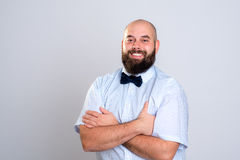 Young bearded man in blue shirt and bow tie Royalty Free Stock Photo