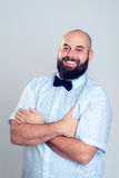 Young bearded man in blue shirt and bow tie Stock Photos