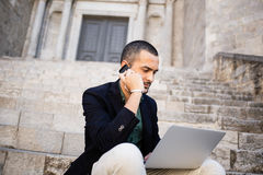 Young bearded man calling over his smartphone Royalty Free Stock Image