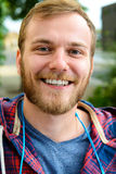 Young bearded man in checkered shirt Royalty Free Stock Photos