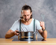 Young bearded man with cooking pot Stock Photography