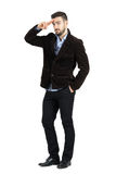 Young bearded man in corduroy coat saluting at camera Stock Photo