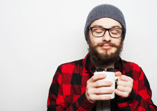 Young bearded man with a cup of coffee Stock Images