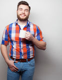 Young bearded man with a cup of coffee Royalty Free Stock Image