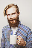 Young bearded man with a cup of coffee Stock Image