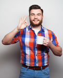 Young bearded man with a cup of coffee Royalty Free Stock Photos