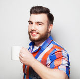 Young bearded man with a cup of coffee Royalty Free Stock Photography