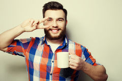 Young bearded man with a cup of coffee Stock Photography