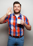 Young bearded man with a cup of coffee Royalty Free Stock Images