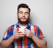 Young bearded man with a cup of coffee Stock Photos