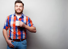 Young bearded man with a cup of coffee Royalty Free Stock Photo