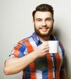 Young bearded man with a cup of coffee Stock Photo