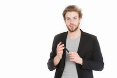 Young bearded man with formal jacket using mobile phone device Stock Photo