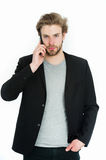 Young bearded man with formal jacket using mobile phone device Stock Image