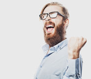 Young bearded man with good idea sign. Royalty Free Stock Photos