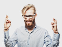 Young bearded man with good idea sign. Stock Images