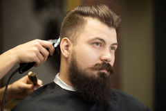 Young bearded man in hairdresser salon Royalty Free Stock Image