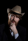 Young bearded man in a hat Stock Photo